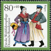 A stamp printed in Germany, is dedicated to Traditional Costumes, shows Rugen, Mecklenburg — Stock Photo