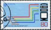A stamp printed in Germany, is dedicated to Transport and communication, shows the Integrated Services Digital Network (ISDN) system — Stock Photo
