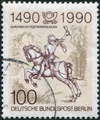 A stamp printed in Germany-West Berlin, is dedicated to the 500th anniversary of postal services in Europe, shows The Young Post Rider, an Engraving by Albrecht Durer — Stock Photo