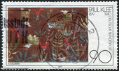 """A stamp printed in Germany, shows a picture of """"Birds in Garden"""", by Paul Klee — Stock Photo"""