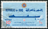 A stamp printed in the Iraq, is dedicated to ending the construction of a deepwater port at Basra. Depicts an oil tanker — Stock Photo
