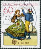 Eine briefmarke gedruckt in deutschland, zeigt eine nördliche paar — Stockfoto