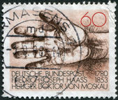 A stamp printed in Germany, dedicated to the 200th anniversary of the birth Dr. Friedrich Joseph Haass, physician and philanthropist, depicted Helping Hand — Stock Photo