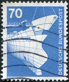 A stamp printed in Germany, is shown Shipbuilding — Stock Photo