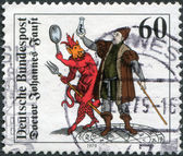 A stamp printed in Germany, shows the Doctor Johannes Faust with Homunculus, Mephistopheles and Faust, Woodcut (1616) — Stock Photo