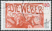 """A stamp printed in Germany, is dedicated to Gerhart Hauptmann, shows a poster for the drama """"The Weavers"""" (Die Weber, 1892) — Foto de Stock"""