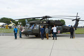 """BERLIN - SEPTEMBER 14: Visitors view the helicopter Sikorsky HH-60 Blackhawk (USAF), International Aerospace Exhibition """"ILA Berlin Air Show"""", September 14, 2012 — Stock Photo"""