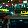 The free taxi on the night street near Potsdamer Platz - Stock Photo