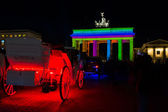 The coach and the Brandenburg Gate in the night light — Stock Photo