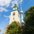 Fernsehturm Berlin with St. Mary's Church in the foreground - Stock Photo