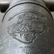Stock Photo: Friedrich Wilhelm symbol on old bronze cannon.