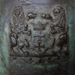 Coat of arms of Gdansk on the old bronze cannon. — Stock Photo