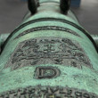 Coat of arms of Gdansk on the old bronze cannon. - Stock Photo