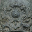 French coat of arms of King Louis XIV (Sun King) on old bronze cannon. — Stock Photo #15772651