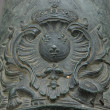 French coat of arms of King Louis XIV (Sun King) on the old bronze cannon. - Stock Photo