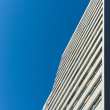 Abstract background of a high-rise residential building and blue sky — Stock Photo