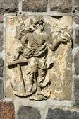 Symbol of hope. Anchor and a woman. Lapidary of Kollnischer Park. Berlin. — Stock Photo