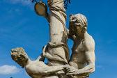 "Sculptra fragment ""Faun tempts Nymph."" Park San Souci. Potsdam. Germany — Stock Photo"