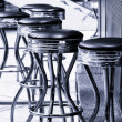 Stock Photo: Bar stools. Black and white. Toning.
