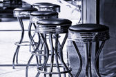 Bar stools. Black and white. Toning. — Stock Photo