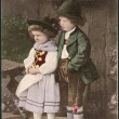 Old German postcard 1906. Shows a girl and a boy in traditional Bavarian dress — Stock Photo #23062314