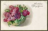 Old German postcard of 1917. Showing flowers in the basket. Inscription in German: Many Pentecostal greeting! — Stock Photo