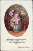 Old German postcard of 1933. Shows a vase of flowers. Inscription in German: Blessed Easter! — Stock Photo