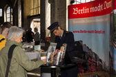 Railway worker sells the steam train — Stock Photo