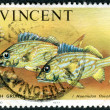 Postage stamp Saint Vincent and the Grenadines, shows a fish the French grunt (Haemulon flavolineatum) - Stock Photo