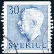 Postage stamp printed in Sweden, shows Sweden's King Gustaf VI Adolf - 图库照片