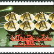 A postage stamp printed in Mongolia, is dedicated to the 11th anniversary of the program Interkosmos, shows a system of satellite antenna — Stock Photo #25120287