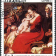 Постер, плакат: A postage stamp printed in Paraguay dedicated to the 300th anniversary of the death of Jacob Jordaens shows Holy Family