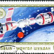 A postage stamp printed in Mongolia shows the docking of spacecraft Soyuz - Apollo — Stock Photo