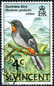 Postage stamp Saint Vincent and the Grenadines, shows a bird the Rufous-throated Solitaire (Myadestes genibarbis) — Stock Photo