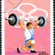 GUINEA - CIRCA 1995: A stamp printed in Guinea, devoted Summer Olympic Games in Atlanta, shows weightlifter, circa 1995 - 图库照片