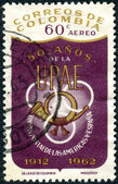 COLOMBIA - CIRCA 1962: A stamp printed in Colombia, dedicated to the 50th anniversary of the founding of the Postal Union of the Americas and Spain, shows a Post Horn, circa 1962 — Stock Photo