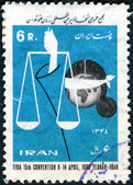 IRAN - CIRCA 1969: A stamp printed in Iran, dedicated to the 15th FIDA (Female Jurists) Convention, Teheran, shows Scales of Justice and Blindfold Globe, circa 1969 — Stock Photo