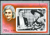 FUJEIRA - CIRCA 1972: A stamp printed in Fujeira, shows an American film actress and sex symbol of the 1930s, Jean Harlow, circa 1972 — Stok fotoğraf