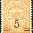 Stock Photo: LUXEMBOURG - CIRC1919: Postage stamps printed in Luxembourg, shows State Emblem (overprint 1924), circ1919
