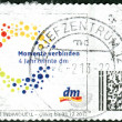 Stock Photo: GERMANY - CIRC2013: Postage stamps printed in Germany, dedicated to 40th anniversary of shops of DM (dm-drogerie markt), circ2013