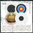 Stock Photo: GERMANY - CIRC2011: Postage stamps printed in Germany, dedicated to 150th anniversary of GermShooting Federation, shows different types of targets, circ2011