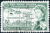 A postage stamp printed in Trinidad and Tobago, is dedicated to the formation of the West Indian Federation, shows Queen Elizabeth II on the background of the Caribbean island, circa 1958 — Stock Photo