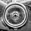 Stock Photo: BERLIN - MAY 11: Headlamp sports car Jaguar XK140 Roadster, (bla