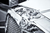BERLIN - MAY 11: The emblem of Jaguar SS-100 roadster (black and — Stock Photo