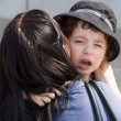 Mom calms weeping children. — Stock Photo
