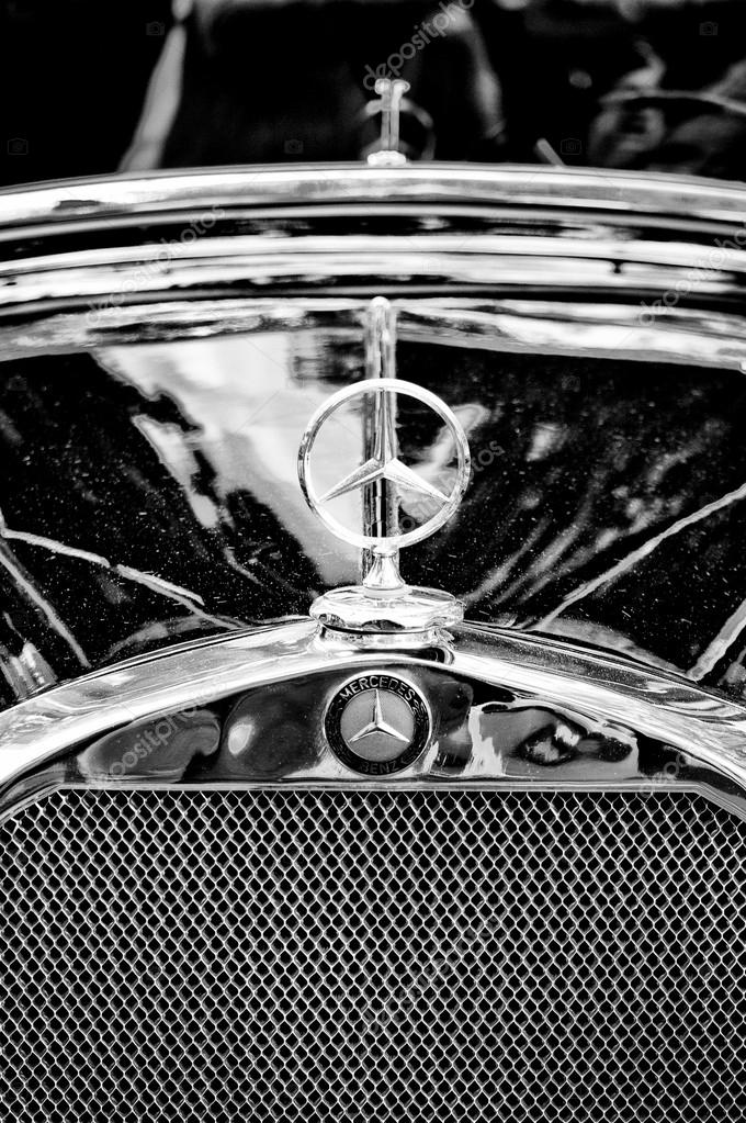 Mercedes benz symbol on the hood black and white stock for Mercedes benz stock symbol