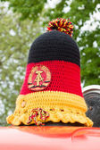 Knitted cap on Emergency vehicle lighting in the style of GDR — Stock Photo