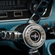 Detail of the steering wheel sports car Ford Mustang Convertible — Stock Photo #30991909