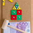 Small house of the children's designer and money. — Stock Photo