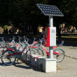 Stock Photo: Bicycle rental company Deutsche Bahn (GermRailways), autonomous (solar panels) work machine to pay rent
